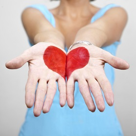 heart drawn on the palms of a woman